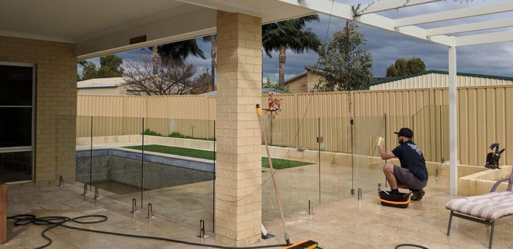 Cleaning up after glass pool fence installation