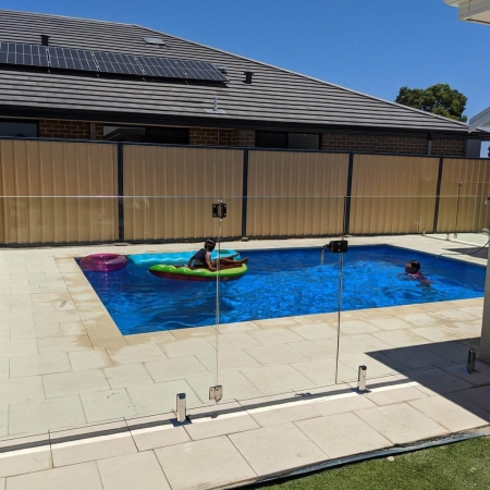 Kids safe swimming with a glass pool fence